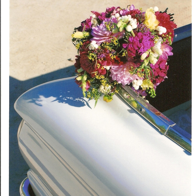 wedding- sara's bouquet on car.jpg