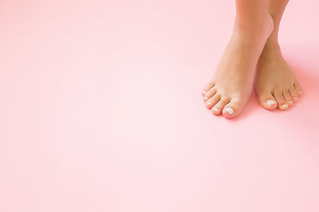 Young, perfect groomed woman's feet on p
