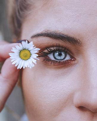 white petaled flower near woman eye_edit