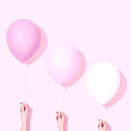 Hands Holding Balloons_edited.jpg