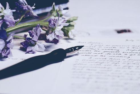 purple flowers on paper_edited.jpg