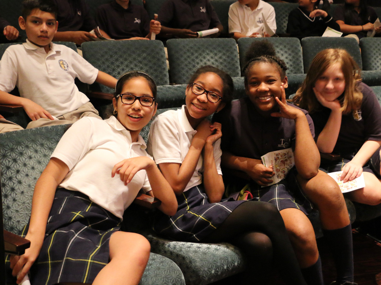 Students smile while waiting for the 2018 School Day Concert to begin at Richardson Auditorium this past May