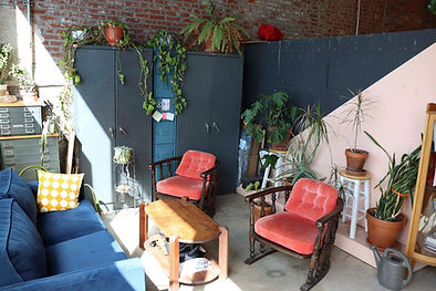Image of the couch lounge area at the front of the Cherry Pit Collectve