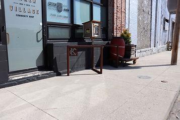 Image of a metal bike rack outside of Maker Village