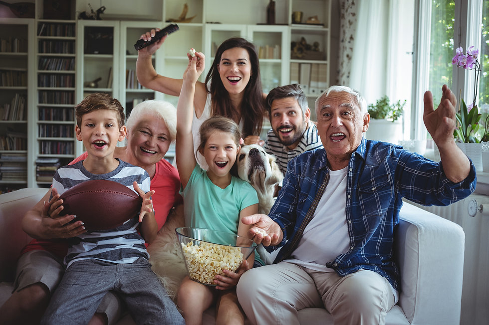 Happy-multi-generation-family-watching-s