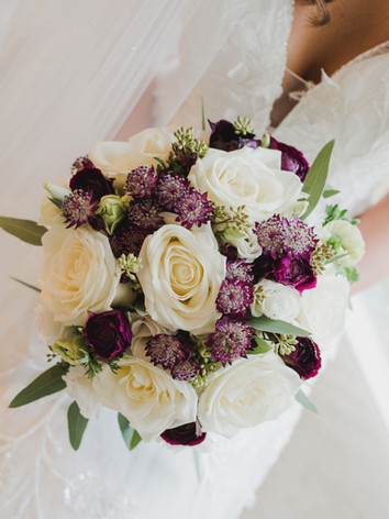 White and purple winter wedding bouquet.