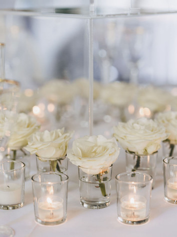 All cream wedding table centre design.
