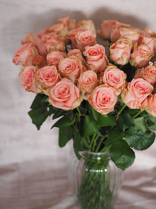Peach Pink Roses in Clear Vase