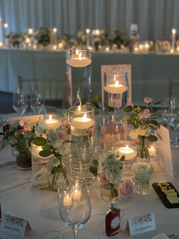 Glass vases and accent flower table centres