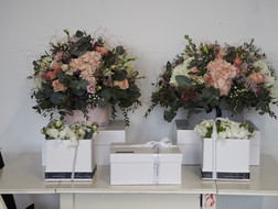 Hat Box flowers with present presentation box below