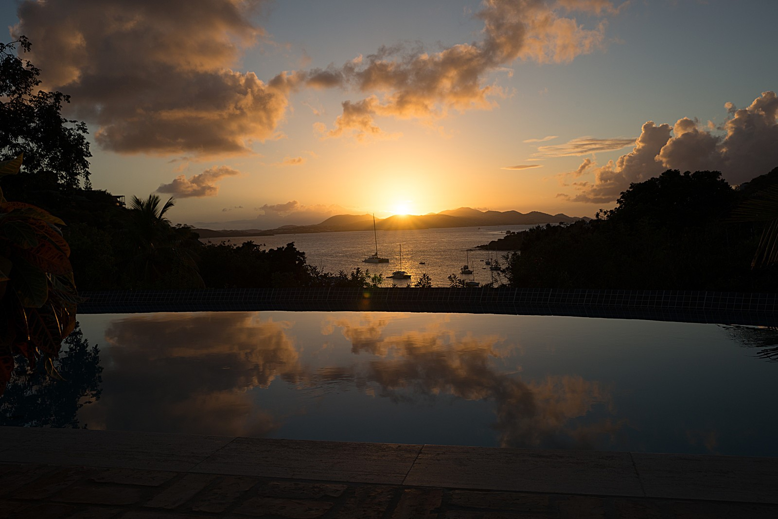 sunset view reflected in pool