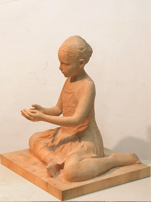 Manuela jugando, 2014, wood, 60 x 55 x 50 cm