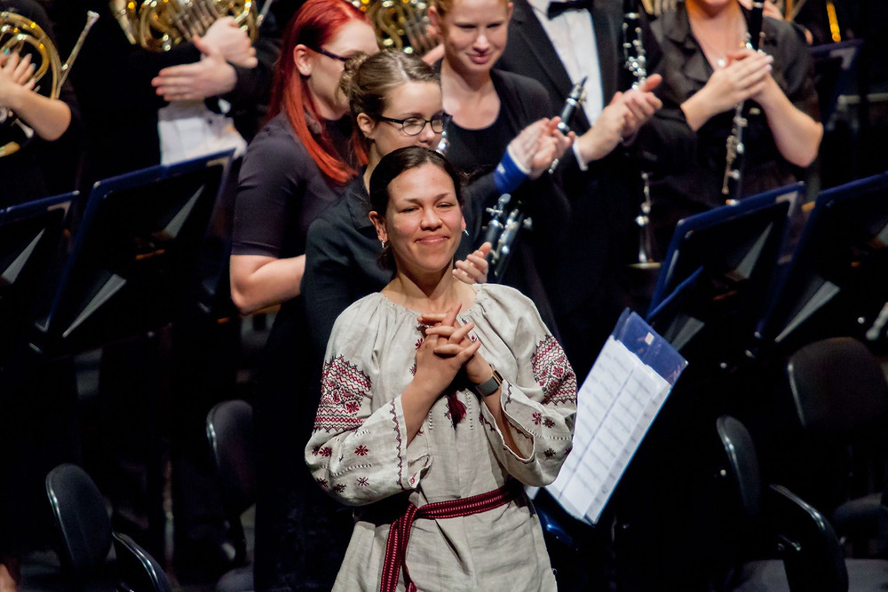 Composer Cathy Likhuta after the Australian première of 'Me Disagrees' with Queensland Conservatorium Wind Orchestra (Peter Morris, conductor), Sept. 2015, photo cred. QCGU