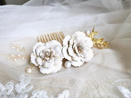The Amelia camellia and rosemary folliage bridal headpiece