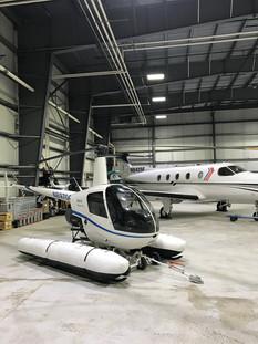 R22 Mariner in hangar