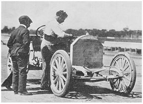 Louis Chevrolet tuning the engine o his FIAT race car
