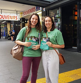 Emily and Tash advertising The Expat Game on Queens Street in Auckland