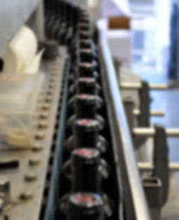 Wine bottles on bottling line