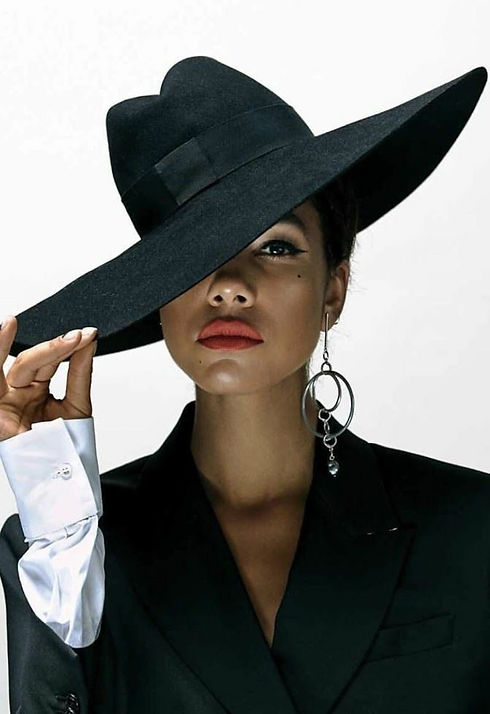 Wide brim hat finishes a look