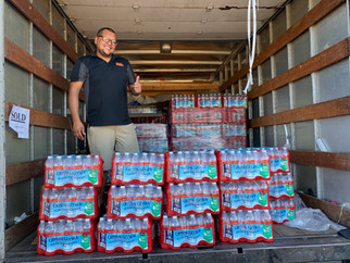 Business owner gives away cases of water