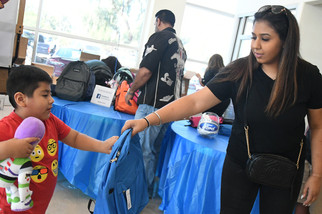 Group to host backpack giveaway