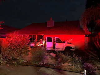 Truck startles family in backyard crash