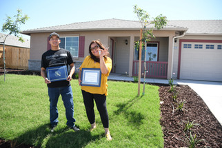 Families receive keys to homes