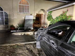 Car plows through house, 1 arrested