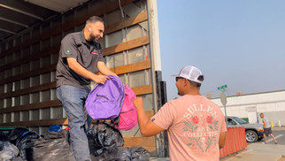 Pacific Farm Management hands out backpacks