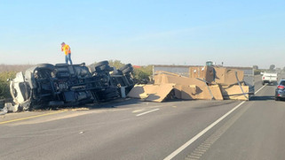 Semi overturns, snarls SR99 traffic