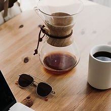 sunglasses-near-teapot-and-filled-cup.jp
