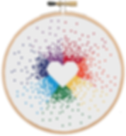 Rainbow Heart cross stitch in a wooden embroidery hoop