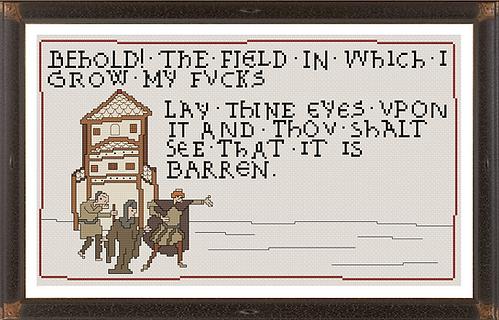 Field of Fucks cross stitch piece in a dark brown frame