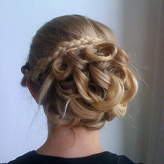 Braid and loose curl up-do for bridal hair