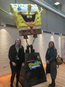 Jenna and Lynne next to a Spongbob Statue