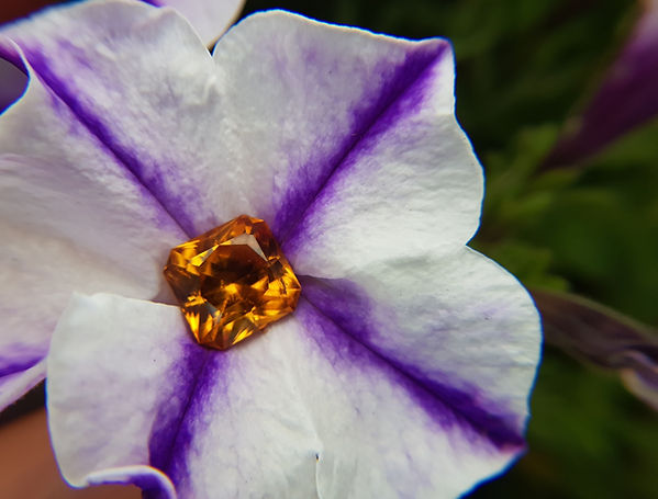 Unusually vibrant imperial topaz gem  in a violet.