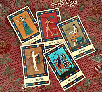 Five Major Arcana cards from The Minoan Tarot, spread out on a cloth