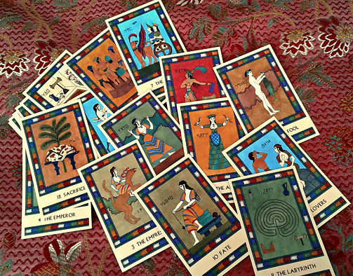 Major Arcana cards from The Minoan Tarot spread out on a cloth