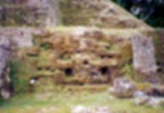 Closeup of a jaguar face on the Jaguar Temple at Lamanai, Belize