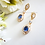 Thumbnail: Oval Sapphire and Clear Baguette Cubic Zirconia Gold Drop Wedding Earrings