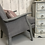Thumbnail: Grey chair with wooden arms