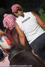 Photo of student riding horse during a holiday camp at Clearwater Bay Equestrian Centre (CEEC)