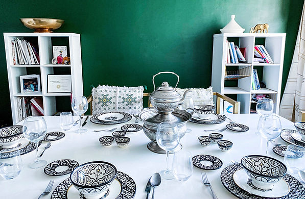 Moroccan Artisan plate set against a jungle green living room wall.