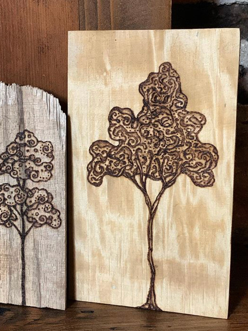 pyrography on black limba and maple
