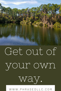 "Motivational and short inspirational quote, ""Get out of your own way"" with a lake, trees and sky in the background."