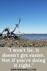 "Short inspirational quote ""It doesn't get easier. Not if you're doing it right with driftwood beach in the background"