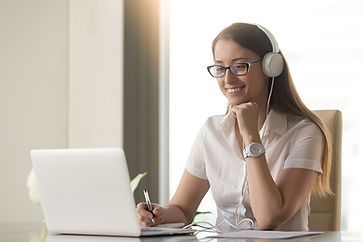 Direct care staff wearing headphones and participating in online training