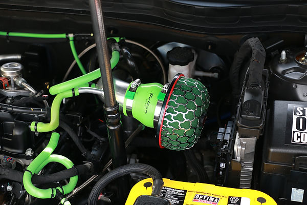 Cold air intake with Green Clamp aid worm gear hose clamp end guards on a modified Kia Optima