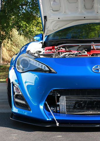 Scion frs Toyota 86 subaru brz with a Supercharger, intercooler with Worm gear hose clamps and blue hose Clamp-aid hose clamp end caps.