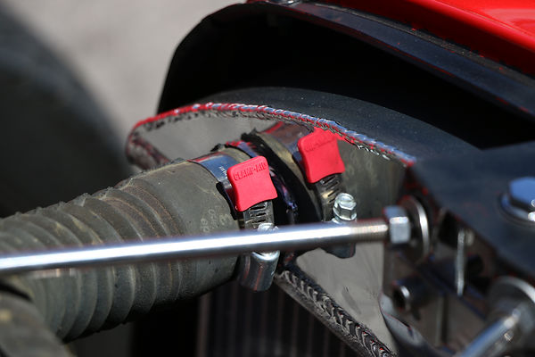 Raiator hose and hose clamp on a hot rod with red end cover